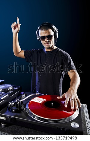 Dj playing disco electro music in a concert - stock photo