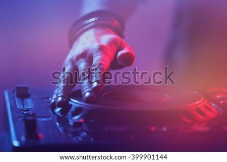 DJ playing music at mixer closeup - stock photo