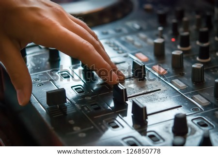 DJ playng on professional mixing controller. Small depth of field - stock photo