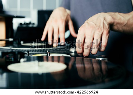 Dj's hands and turntable - stock photo