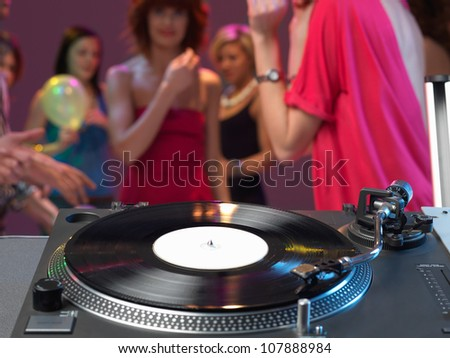 dj's turntable closeup in a night club - stock photo
