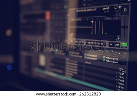 Dj software on a computer screen, shallow focus - stock photo