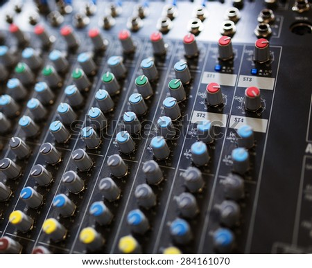 DJ sound mixer from top view, soft focus - stock photo