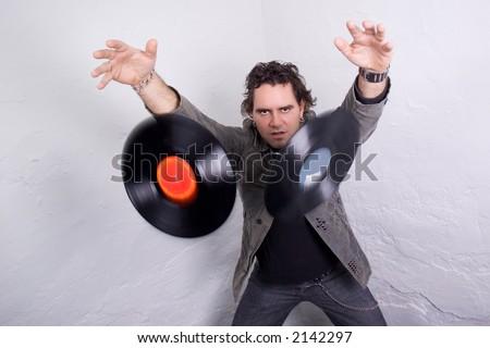 DJ throwing two vinyl records - stock photo