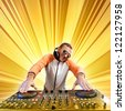DJ with a mixer equipment to control sound and play music - stock photo