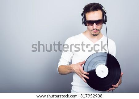Dj with headphones and vinyl  - stock photo
