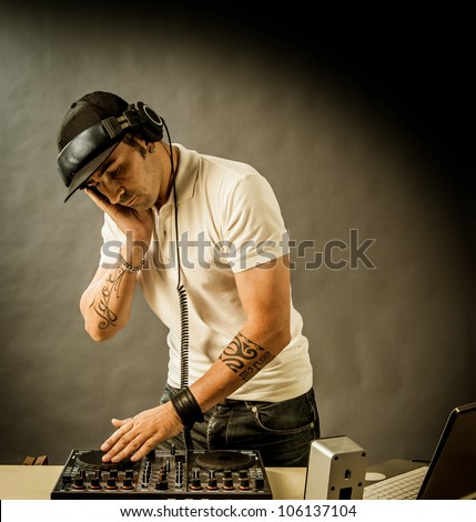DJ with mixer is working , photo with copyspace