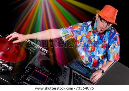 DJ with table with Club Lights in the background - stock photo