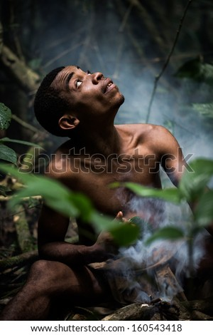 DJA FOREST, CAMEROON - AUG 5: Male pygmy in the forest, forest pygmies could lose their habitat due to logging companies and ivory traffickers on Aug 5, 2013 in the Dja forest, Cameroon - stock photo