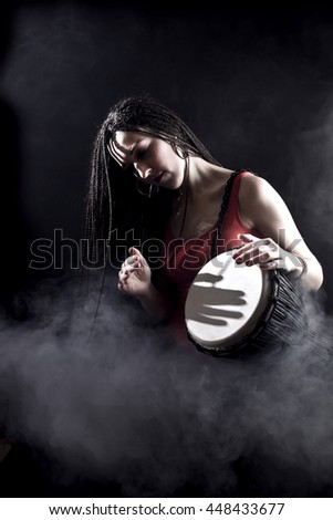 djembe player in smoke