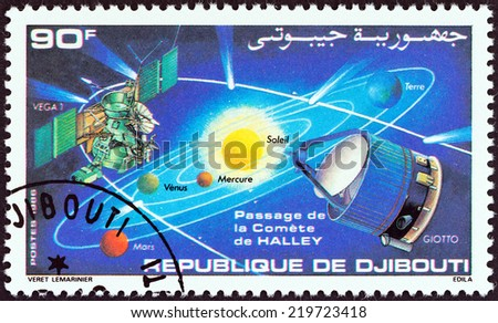"""DJIBOUTI - CIRCA 1986: A stamp printed in Djibouti from the """"Appearance of Halley's Comet """" issue shows Solar system, comet trajectory and space probes Giotto and Vega 1, circa 1986. - stock photo"""