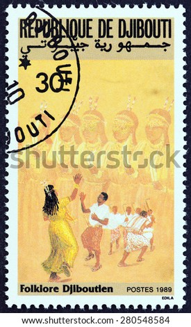 "DJIBOUTI - CIRCA 1989: A stamp printed in Djibouti from the ""Folklore "" issue shows Dancers, circa 1989. - stock photo"