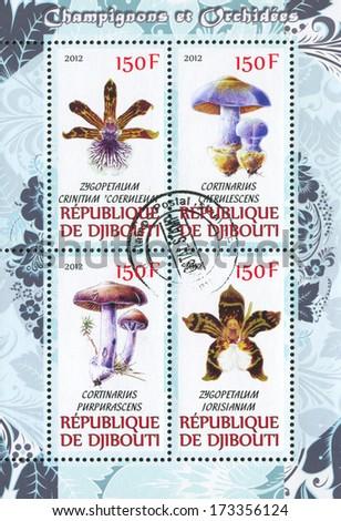 DJIBOUTI - CIRCA 2012: stamp printed by Djibouti, shows flower and mushroom, circa 2012 - stock photo