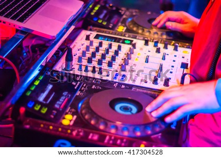DJs are turntablism turntables plate mixer night party pub Motion blur abstract background. - stock photo