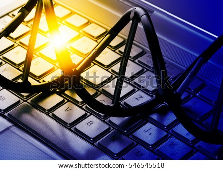 DNAl molecule model on computer keyboard. Artificial intelligence concept