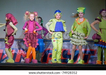 "DNEPROPETROVSK, UKRAINE - APRIL 9: Children's fashion theater ""Mal-a-hit"" presents a collection of ""Gogoriki"" at the ""Fashion town"" festival  on April 9, 2011 in Dnepropetrovsk, Ukraine"
