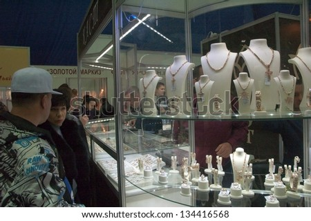 DNEPROPETROVSK, UKRAINE - APRIL 7:  Visitors visit Jewellery House KAST booth during Jewelry exhibition  �«Dnepr Deluxe Festival�» on April 7, 2013 in Dnepropetrovsk, Ukraine - stock photo