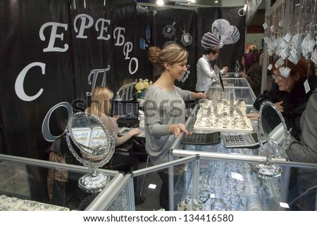 DNEPROPETROVSK, UKRAINE - APRIL 7:  Visitors visit Jewellery House SILVER booth during Jewelry exhibition  �«Dnepr Deluxe Festival�» on April 7, 2013 in Dnepropetrovsk, Ukraine - stock photo