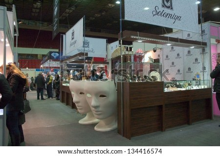 DNEPROPETROVSK, UKRAINE - APRIL 7:  Visitors visit Jewellery House Solomija booth during Jewelry exhibition  �«Dnepr Deluxe Festival�» on April 7, 2013 in Dnepropetrovsk, Ukraine - stock photo
