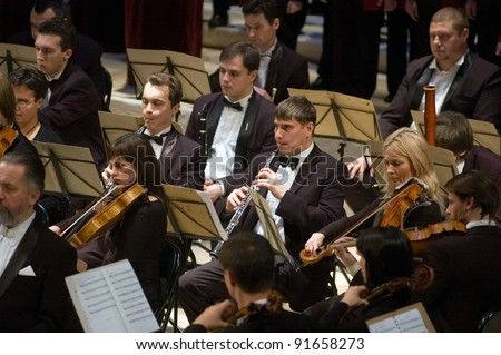 "DNEPROPETROVSK, UKRAINE - DECEMBER 26: ""Christmas Oratorio"" by metropolitan Hilarion  performed by Symphony Orchestra of the Kharkov Philharmonic on December 26, 2011 in Dnepropetrovsk, Ukraine - stock photo"