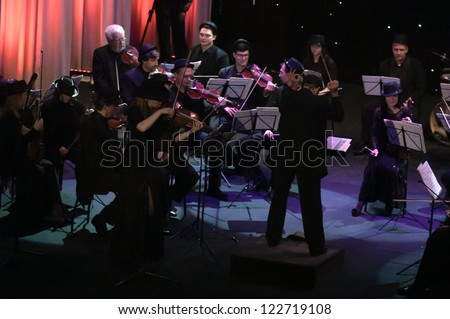 "DNEPROPETROVSK, UKRAINE-DECEMBER 24: National Ensemble artists ""Kyiv Camerata""- main conductor Valery Matyukhin perform ""Ciao, muchacho"" of V.Zubitsky on December 24,2012 in Dnepropetrovsk, Ukraine"