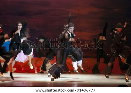"DNEPROPETROVSK, UKRAINE - DECEMBER 17: Unidentified girls, ages 12-14 years old, perform musical spectacle "" Red Sails"" on December 17, 2011 in Dnepropetrovsk, Ukraine"