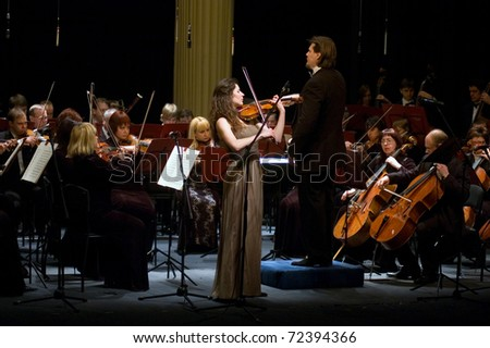 "DNEPROPETROVSK, UKRAINE - FEBRUARY 28: ""Violin Concerto"" by Peter Tchaikovsky performed by Maria Shamshina and Academic Symphony Orchestra on February 28, 2011 in Dnepropetrovsk, Ukraine"