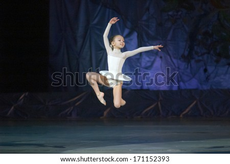 DNEPROPETROVSK, UKRAINE -?? JANUARY 12: An unidentified girl, age 7 years old, performs Ballet pearls at State Opera and Ballet Theatre on January 12, 2014 in Dnepropetrovsk, Ukraine