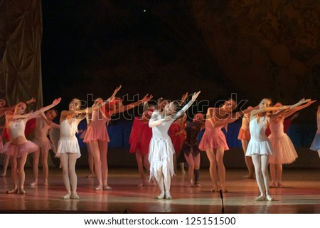 DNEPROPETROVSK, UKRAINE - JANUARY 13: Unidentified girls, ages 8-15 years old, perform Ballet pearls at State Opera and Ballet Theatre on January 13, 2013 in Dnepropetrovsk, Ukraine