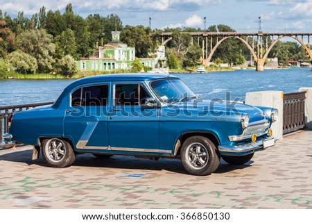 DNEPROPETROVSK, UKRAINE - July 18, 2015: Retro car GAZ-21 Volga parked on the embankment by the river.