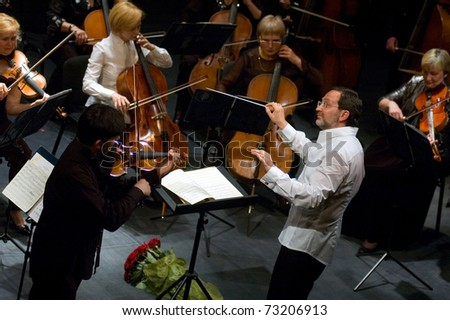 DNEPROPETROVSK, UKRAINE-JUNE 15: 'Four seasons' Chamber Orchestra - main conductor Dmitry Logvin performed music of Elgar, Bruch, Tchaikovsky on June15,2009 in Dnepropetrovsk, Ukraine