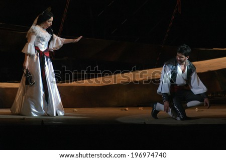 DNEPROPETROVSK, UKRAINE - JUNE 1: Members of the Dnepropetrovsk State Opera and Ballet Theatre perform CARMEN on June 1, 2014 in Dnepropetrovsk, Ukraine  - stock photo