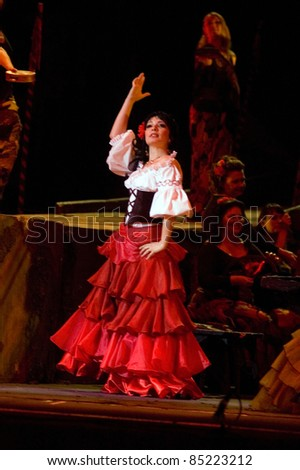 "DNEPROPETROVSK, UKRAINE  JUNE 3: Members of the Dnepropetrovsk State Opera and Ballet Theatre perform "" Carmen "" on June 3, 2011 in Dnepropetrovsk, Ukraine - stock photo"