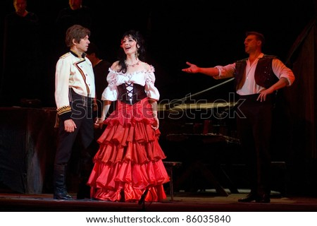 "DNEPROPETROVSK, UKRAINE - JUNE 3: Members of the Dnepropetrovsk State Opera and Ballet Theatre perform "" Carmen "" on June 3, 2011 in Dnepropetrovsk, Ukraine - stock photo"