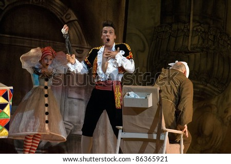 "DNEPROPETROVSK, UKRAINE - JUNE 25: Members of the Dnepropetrovsk State Opera and Ballet Theatre perform ""The Barber of Seville"" on June 25, 2011 in Dnepropetrovsk, Ukraine"