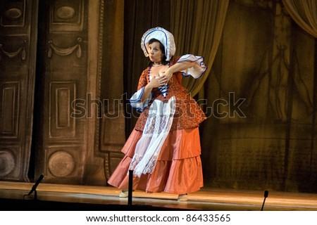 "DNEPROPETROVSK, UKRAINE - JUNE 25: Members of the Dnepropetrovsk State Opera and Ballet Theatre perform "" The Barber of Seville "" on June 25, 2011 in Dnepropetrovsk, Ukraine"