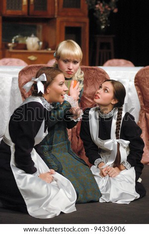 "DNEPROPETROVSK, UKRAINE - JUNE 2:  Members of the Dnepropetrovsk State Russian Drama Theatre perform ""Children Vaniushin"" on June 2, 2005 in Dnepropetrovsk, Ukraine"