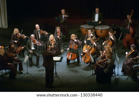 "DNEPROPETROVSK, UKRAINE - MARCH 4: ""Four seasons"" Chamber Orchestra - main conductor Dmitry Logvin perform music of  Mendelssohn on March 4, 2013 in Dnepropetrovsk, Ukraine"