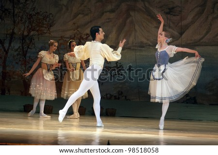 "DNEPROPETROVSK, UKRAINE - MARCH 25: Members of the Dnepropetrovsk State Opera and Ballet Theatre perform ""Giselle"" on March 25, 2012 in Dnepropetrovsk, Ukraine"