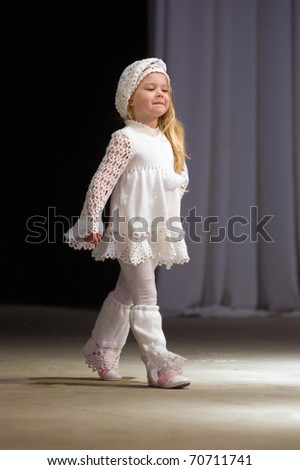 DNEPROPETROVSK, UKRAINE - MARCH 25: unidentified Ukrainian baby shows off his own clothes for unidentified young Ukrainian designer at FASHION TOWN  show on March 25, 2010 in Dnepropetrovsk, Ukraine