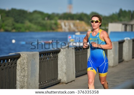 DNEPROPETROVSK, UKRAINE - MAY 24, 2014: Anna Abdulova of Ukraine runs on the third stage of ETU Sprint Triathlon European cup. It's the first time Triathlon European Cup take place in Ukraine - stock photo