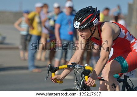 DNEPROPETROVSK, UKRAINE - MAY 24, 2014: Hanna Maksimova of Belarus races in the cycling stage of ETU Sprint Triathlon European cup. It's the first time Triathlon European Cup take place in Ukraine