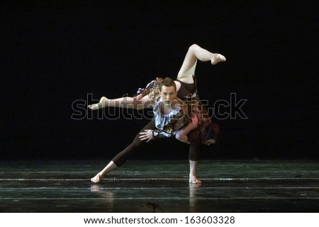 DNEPROPETROVSK, UKRAINE - MAY 18: Members of the TOTEM DANCE GROUP perform THOUGHTS at State Opera and Ballet Theatre on May 18, 2013 in Dnepropetrovsk, Ukraine