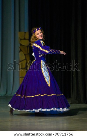 "DNEPROPETROVSK, UKRAINE - MAY 22: Unidentified 14-year-old girl performs in the musical spectacle "" The Blue Bird"" on May 22, 2010 in Dnepropetrovsk, Ukraine"