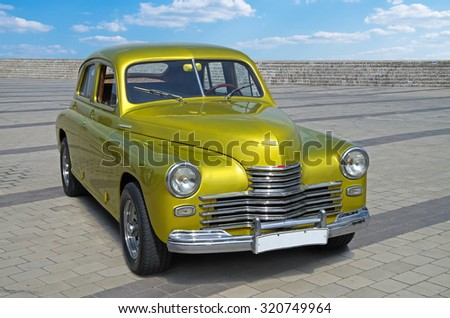 DNEPROPETROVSK, UKRAINE - November 28, 2013: Exhibition of cars and other vintage motorcycle technics - stock photo