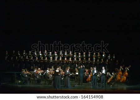 DNEPROPETROVSK, UKRAINE - NOVEMBER 23: Members of the Choir and Symphonic Orchestra of the State Opera and Ballet Theatre perform Mozart's REQUIEM on November 23, 2013 in Dnepropetrovsk, Ukraine - stock photo