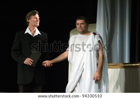 "DNEPROPETROVSK, UKRAINE - NOVEMBER 11: Members of the Dnepropetrovsk State Russian Drama Theatre perform "" Forget Herostratus"" on November 11, 2007 in Dnepropetrovsk, Ukraine"