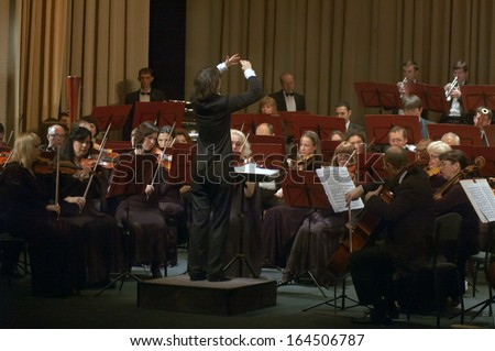 DNEPROPETROVSK, UKRAINE - NOVEMBER 25: Members of the Symphonic Orchestra - main conductor Natalia Ponomarchuk perform music by Gustav Mahler on November 25, 2013 in Dnepropetrovsk, Ukraine