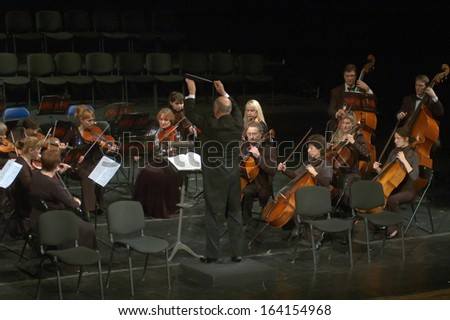DNEPROPETROVSK, UKRAINE - NOVEMBER 23: Members of the Symphonic Orchestra of the State Opera and Ballet Theatre perform ADAGIO on November 23, 2013 in Dnepropetrovsk, Ukraine