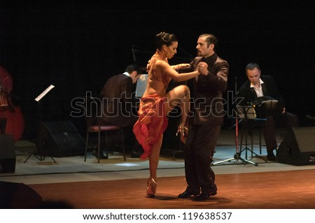 "DNEPROPETROVSK, UKRAINE - NOVEMBER 22: The dancers Janina Quinones and Neri Piliu (Argentina, Buenos Aires) at ""World Stars Tango"" show on November 22, 2012 in Dnepropetrovsk, Ukraine"